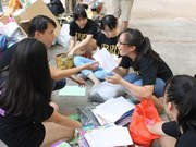 Student group recycles paper for notebooks
