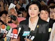 Former Thai PM appears before court for rice subsidy trial