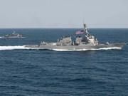 US warship sails near illegally built islands on East Sea