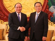 Lao leaders hail cooperation with Vietnam