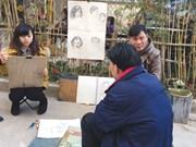 Street art fair entertains Hanoians at cultural hub