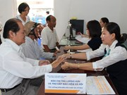 HCM City: More districts launch pension payment service via post