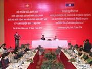 Vietnam, Laos share experience in public debt management