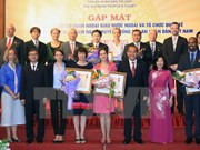 Int'l organisations awarded with Vietnam's court insignia