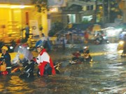 HCM City struggles to cope with record rainfall, floods