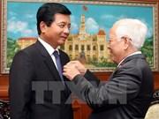 Lao Ambassador receives Ho Chi Minh City insignia