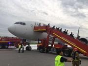 Singaporean plane makes emergency landing, catches fire