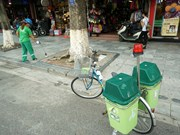 Hanoi trash collectors using bikes
