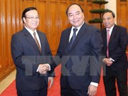 Deputy PM seeks Laos' support to Vietnam-invested projects