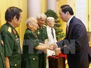 State leader hails contributions by former volunteers in Laos