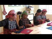 Ethnic people make fortune in brocade craft