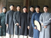 Cultural event helps revive ao dai for men