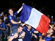 Vietnamese, French football fans celebrate France's World Cup victory