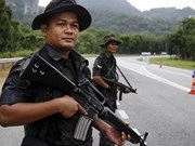 Malaysia deports eight Indonesians for carrying IS logo