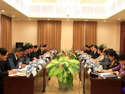 Offices of Vietnam, Laos Party Central Committees reinforce ties