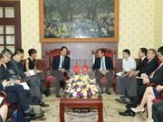Xinhua President visits Nhan Dan newspaper