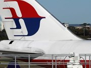 Malaysia Airlines plane returns to Australia over bomb threat