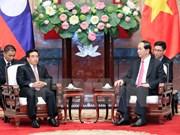 President Tran Dai Quang hails Lao Vice President's visit