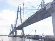 Final sections of Vam Cong bridge spanning Hau River joined