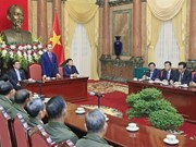 President receives Lao people with contributions to VN revolution