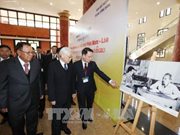 Vietnamese, Lao leaders attend exhibition on special solidarity