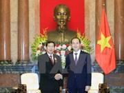 President Tran Dai Quang receives Lao supreme court chief