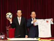 PM presents U23 team's ball, shirt to raise funds for the poor