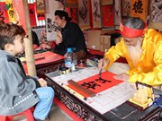 Tet event features folk art, calligraphy