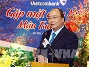 PM lauds Vietinbank, Vietcombank's business results last year