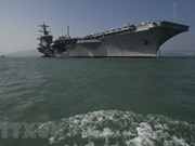 Vietnam officials visit US aircraft carrier