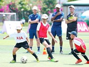 English football coaches train kids in Vietnam