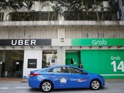 Singapore investigates Grab-Uber merger
