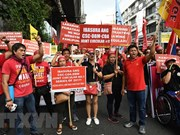 Philippine workers march to call for labour issue settlement