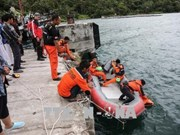 Indonesia police suspect criminal offence behind capsized boat