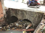 Litter in canals, sewers worsens floods in HCM City