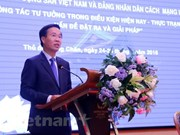 Vietnamese, Lao parties hold theoretical workshop