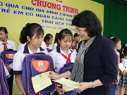 Vice President presents gifts to disadvantaged families, children