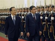 France, China sign bilateral cooperation deals