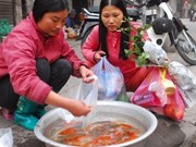 Tet traditions honour Kitchen Gods