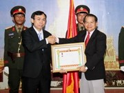 Laos honours Hanoi trade union