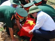 Ha Tinh holds reburial ceremony for 54 fallen soldiers