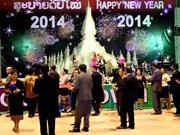 Lao people gather to see New Year in
