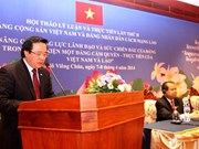 Vietnam, Laos wrap up theory conference