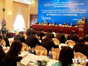 VN, China parties share experience in law-governed state building