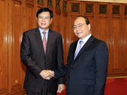 Deputy PM hosts Lao economic commission head