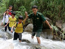 Students walk bumpy roads to school in  mountainous areas