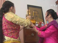 Incense keeps burning on Ho Chi Minh's altar in Laos