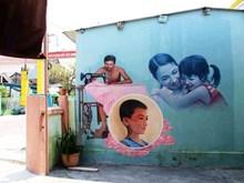 Mural brightens up Tam Thanh fishing village