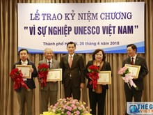 20 individuals presented with UNESCO Vietnam insignia