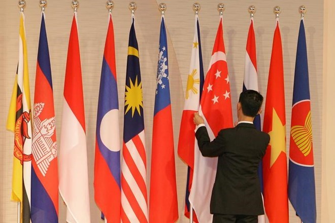 Three pillars of to be formed asean community vietnam vietnamplus the asean flag first right and the flags of the blocs member nations photo straitstimes malvernweather Images